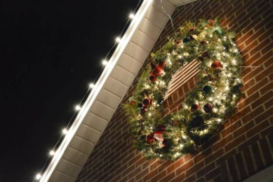 Christmas Light Installation.Professional Xmas Light Installer Black Belt Window
